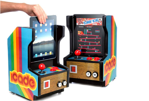 ThinkGeek (partnered with ION) designs the iCADE Arcade Cabinet. The retro styled accessory is ready to dock an iPad, complete with Bluetooth and the option to purchase classic Atari games such as Asteroids, Centipede, and Battlezone. (first discovered via Bless This Stuff)