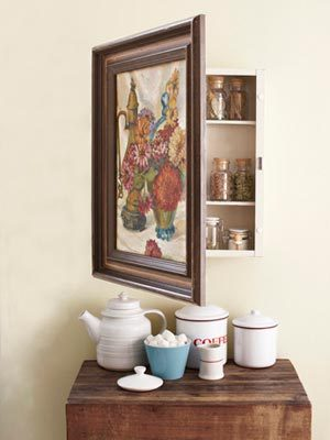 scissorsandthread:  Turn A Vintage Painting Into A Cabinet | Country Living If I ever get to build my own house, I am definetly going to have a hidden room! What I'm imagining is a lovely library… but when you press on a particular book shelf… pop! It opens to reveal a hidden stair case… that leads to a beautiful room with comfy chairs and maybe some secret windows! Yeah so that's why I would never be able to afford to build my dream house! But I would still love something secret in my house, a piece of furniture that only I know the mysteries behind! This is perfect because it reminds me of in the movies where they open the painting to reveal the safe! I don't know what I would put in mine because I don't really have any expensive jewels, maps to jewels or bundles of cash!
