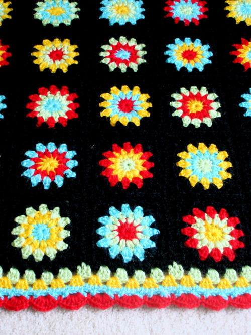 bamboocotton:  Granny Burst Baby Blanket.  This was a stash project, but the yarn is so irresistibly soft that you can't help but want to snuggle up inside it.  That is, if the blanket were larger or you were the size of a baby.
