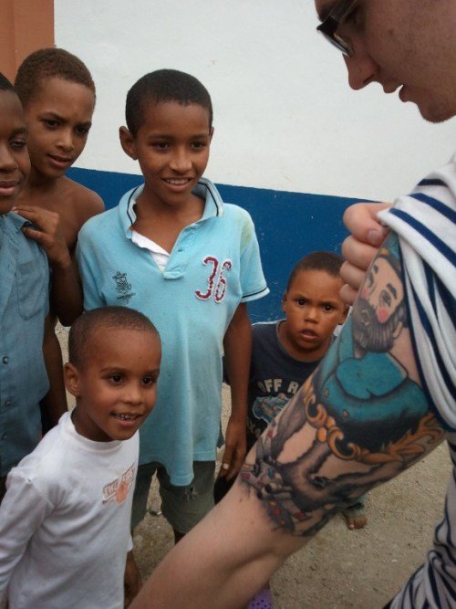 fuckyeahtattoos:  I went to the Dominican Republic a few weeks ago to volunteer for an organization called Compassion International and this was one of the coolest moments of my entire trip. This community of young kids had never seen a tattoo in their life. It was amazing. It was just funny how a silly thing like a half-sleeve could break a language barrier. Tattoos by Kevin Jarvis (www.kevinjarvisartwork.com)