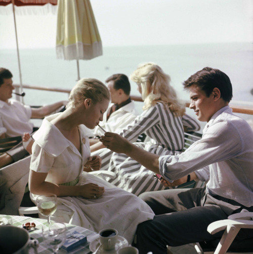"nickelcobalt:  Cannes 1959 - Alain Delon & Romy Schneider ""What you need, what you deserve, is a guy who adores you for what you are. Who doesn't see you as a project, but a prize. you know?"" —Sarah Dessen (The Truth about Forever)"