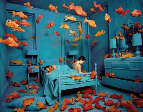 "installation by Sandy Skoglund ""Skoglund creates surrealist images by building elaborate sets or tableaux, furnishing them with carefully selected colored furniture and other objects, a process of which takes her months to complete. Finally, she photographs the set, complete with actors."""