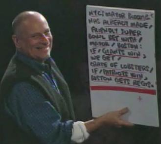 Late Show with David Letterman cue card boy Tony Mendez holding a card with a joke that I wrote for the January 21, 2008 show. It was just before Super Bowl XLII between the Giants and Patriots. Here was the joke as submitted: Mayor Bloomberg and the mayor of Boston have already made the traditional Super Bowl bet. Here's the deal: if the Giants win New York gets a crate of lobsters. If the Patriots win, Boston gets Regis. You can see all of my jokes that Dave told over the years here.