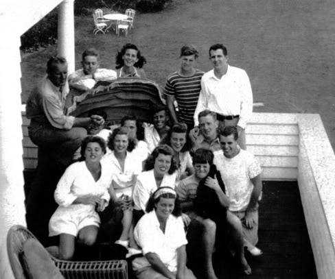 The family gathered ay Hyannis Port in 1944 with Jack's navy buddies Jim Reed, Len Thom, Barney Ross and Red Fay (and their wives). One of the last pics of the family still intact. Joe Jr., incidently, is obscured by Red Fay's hand at the left.