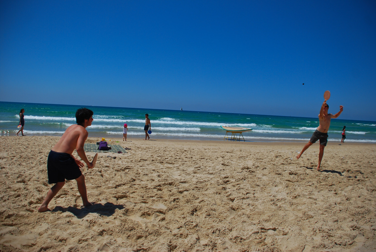 May 10. Yom Ha'atzmaut. Nate and Brian play paddle ball on the beach.