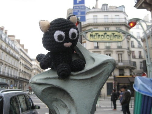 Travel Cat in France:   Travel Cat explores the streets of Paris.