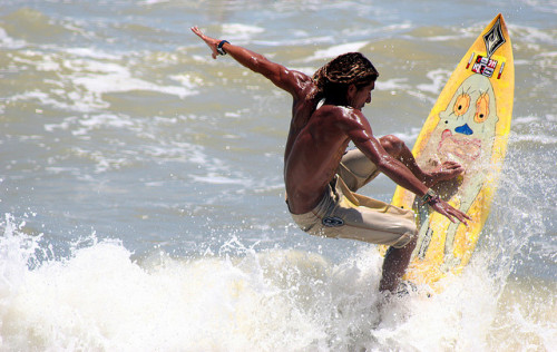 A local surfer surfing a simple wave in Ceara, Brazil.