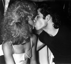 I got John Travolta to kiss Olivia Newton John at the Grease party back in 1978. Much better then having them just mug for my camera. Travolta lived in my building, but I never saw him.