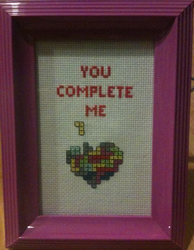 Tetris 'You Complete Me' I can change the colour scheme to fit the version of Tetris that you prefer. Also the frame comes in yellow, green and blue as well. $15