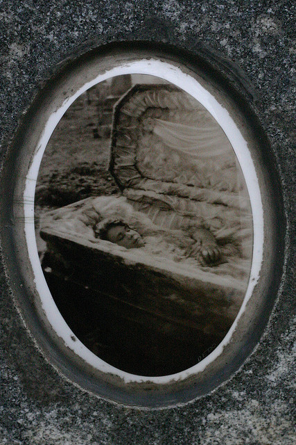 "Julia Buccola Petta in 1927, exhumed after 6 years in the grave by johnmartine63 on Flickr. Here's the story: Julia Buccola Petta (1892-1921), also known as ""The Italian Bride,"" was a housewife who died in childbirth. From Wikipedia:  Following her death, Petta was buried at Mount Carmel Cemetery in the Chicago, Illinois suburb of Hillside. Petta was buried in her wedding dress. A photo of Petta in her wedding dress was placed on her monument, which also features a statue of her based on this photo. Soon after Petta's death, her mother began experiencing dreams in which Petta was telling her that she was still alive. Six years after Petta's death, Filomena secured permission to have the grave opened and her daughter exhumed. The coffin was found to have decomposed, but when it was opened Petta's body was still intact - her body had not decayed at all. Her mother took a picture of Petta in her casket, which was placed on the monument and is still there to this day."