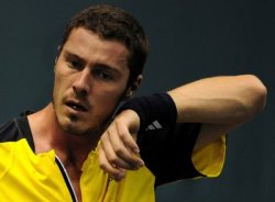 Marat Safin. Sweating never looked so good.  Sorry. I'm in the mood to search up pics of unusually attractive men.