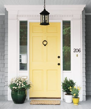 (via Potted plants flanking an entry door are warm and welcoming. | 22 Container Gar)