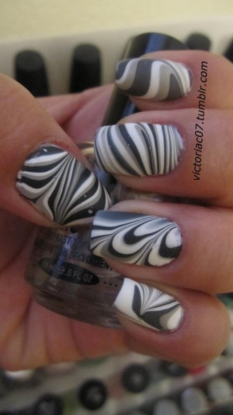 I mattified my water marble from yesterday with Essie's Matte About You.  I was curious to see what it looked like, and just generally love the effect of Matte top coats! Colors used: Sally Hansen X-treme Wear - Wet Cement Sally Hansen X-treme Wear - Black Out Ulta Professional - Angel Baby Essie Matte About You