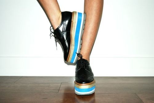 Balancing in brogues.