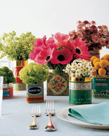 thingskatelikes:  tea tin centerpieces via Martha Stewart Weddings