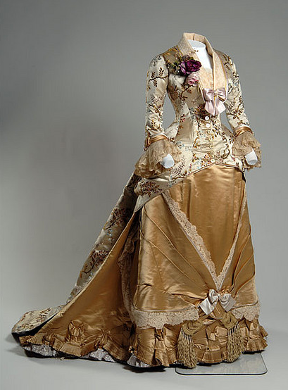 ornamentedbeing:    Gown, 1878 Emile Pingat Cream silk brocade, lace, gold and yellow satin. Worn by Mrs. Augustus Newland Eddy. This gown is one of more than 60 couture pieces featured in the exhibition Chic Chicago: Couture Treasures from the Chicago History Museum. © Chicago History Museum