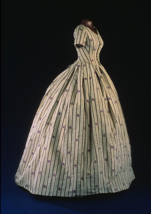 (Formerly) evening dress worn by First Lady Mary Todd Lincoln, 1861 United States, Smithsonian Museum of American History This dress originally had an evening bodice, but it was replaced later in the century with the day bodice you see here, made from fabric from the skirt.  I can't imagine her fitting into this bodice…It must have been meant for display.
