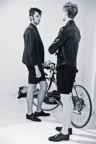 Silviu Tolu, Matthew Hitt and a bicycle.  Backstage at J. Sabatino S/S 11.