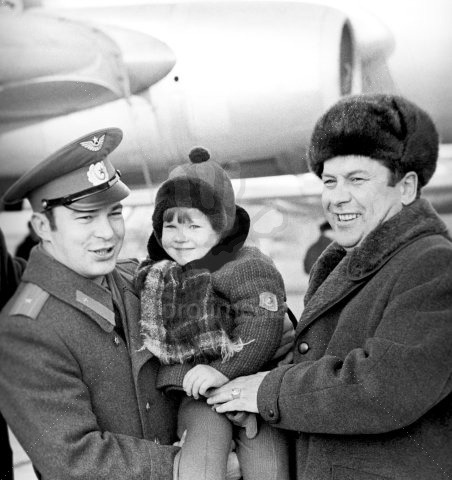 Another set of father and son cosmonauts: Yuri Romanenko (left) holding his son Roman in 1977. Roman later became the third second-generation space traveler in 2009. (That's Pavel Popovich on the right)