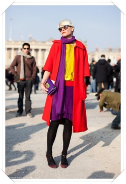 Stockholm street style by Elisa Nalin. It's an interesting mix of colors. Black leggings neutralize the bright colors on top. Great colorblocking!