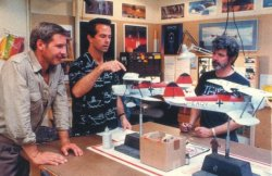 Harrison Ford and George Lucas brushing up on their model airplane knowledge for Indiana Jones and the Last Crusade.