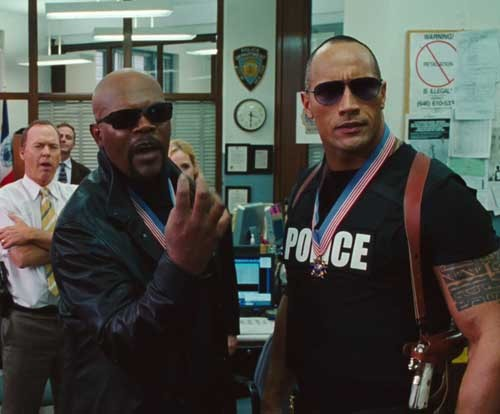 "50 Coolest Movie Cops 21. The Other Guys (2010)The Cool Cops: Detectives Chris Danson (Dwayne Johnson) and P.K. Highsmith (Samuel L. Jackson)Coolest Moment: ""Aim for the bushes."" Danson and Highsmith show how fearless they are (and also fearsomely stupid) when they launch themselves off the top of a building after crims who're getting away. It doesn't end well.If They'd Been From Blighty: They'd have met their maker after plunging from the top of the Gherkin."