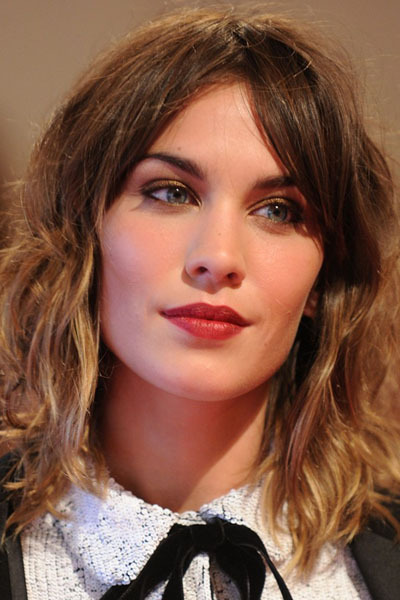 Alexa Chung's Warm Defined Eyes and Red Lips at the Met Ball —- I love how this classic look is made up of warm tones, and looks soft yet polished at the same time.  Get the look with a red-brown shadow like MAC Sable, and black liner very close to the upper lash line, and just at the outer corners of the lower lashes. The blusher is matte and warm (try a shade like MAC Foolish Me), and lips a deep, matte red.