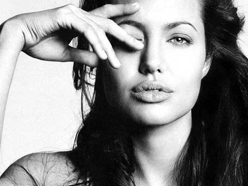 "Angelina Jolie's In the Land of Blood and Honey picked up FilmDistrict has bought the rights to Angelina Jolie's directorial debut In the land of Blood and Honey, GK Films has announced in Cannes.Shot in Bosnia last year, the film focuses on a Bosnian woman and a Serbian man who are separated during the war.The film stars Zana Marjanovic, Rade Serbedzija and Goran Kostic and was filmed simultaneously in both English and BHS (formerly Serbo-Croatian) languages.In a statement, Jolie said, ""The film is specific to the Bosnian War, but it's also universal. I wanted to tell a story of how human relationships and behavior are deeply affected by living inside a war."""