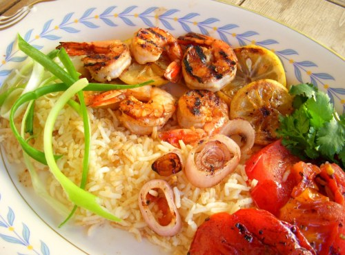 Grilled Shrimp Platter This was very yummy and so easy. Marinate peeled and de-veined shrimp in the juice of 1 orange or tangerine, the juice of 1/2 lemon, 2 tblsp olive oil, 1/2 tsp fresh grated ginger, 1 large freshly grated garlic clove, 1/4 tsp chili flakes or Sambal Oelek, 1 tsp soy sauce, 1 tsp apricot jam and salt and pepper. Cook some rice in veggie broth. Skewer the shrimp onto skewers alternating with slices of the other half of the lemon. Slice a tomato in half and sprits with olive oil spray or any cooking spray you have on hand. Chop a shallot into rings and sprits with olive oil spray. Slice a green onion lenghtwise and put it in ice water to curly up.Heat a grill pan to high and grill the shrimp skewers until pink and cooked through, also grill the shallots and tomato. Serve with a garnish of cilantro.