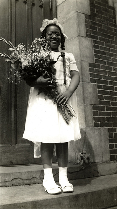 Audre Lorde (1934-1992), ca. early 1940s, as a Roman Catholic schoolgirl, dressed for her First Communion.  (via afrodiaspores) thegang Via curate