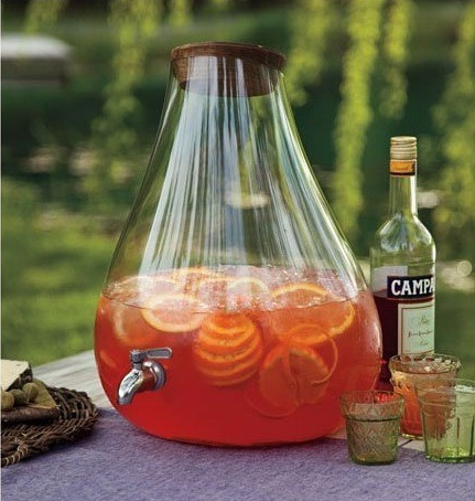 "Banchetto Handblown Glass Drink Dispenser If you are a person capable of affording the most luxurious of tastes, you probably don't frequent this blog. However, for those stopping by, this mouth-blown beauty will dispense your finest sangrias, iced teas or what have you in style.  Features an angled top with a sustainable rosewood stopper, and a dripless, stainless-steel spigot. Hand wash. Imported. Approx. 14¾"" diam., 16¼"" h.; 4 gallons.  $329 @ Amazon.com Also check out the rest of NapaStyle.com if you're into nice glassware. They seem to have quite a few interesting products that would make nice gifts."