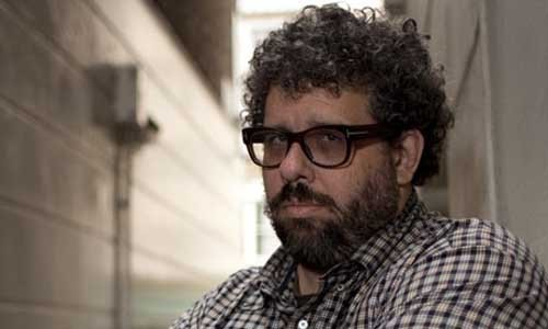 "Cannes 2011: Neil LaBute talks Crooked House We were a little surprised to hear that Neil LaBute would be directing Agatha Christie adaptation Crooked House, so we decided to quiz him about it.When we caught up with the writer-director in Cannes, we sat down with him for an intriguing Q and A:How did you get involved in this?""Every decade I like to take a hallowed English writer and adapt their work and prepare myself to be stoned. First it was A.S. Byatt and now Agatha Christie. I'll get to Coward and Wilde eventually.""But seriously, I saw Julian Fellowes' script and I like a mystery and I thought everything from the title on down was intriguing.""What did you like?""This one has never been touched on television or film; it was sort of outside the safe zone for her in terms of having a romance as well as the requisite murders.""And when I realised it was quite morally questionable by the end, I was like, ""Wait, they're singing my siren song."" It's her 49th book, I think, but she still had a difficult time with her publishers with Crooked House, who did not want it to end the way it did.""It's that nice grey zone of morality that I like to operate in.""Matthew Goode and Gemma Arterton are your lovers, then…""She's an heiress whose grandfather passes away. She believes he was murdered and brings a beau from her past who's now working at Scotland Yard into the mix, so that bristling tension that they never quite made it as a couple comes to the surface."""