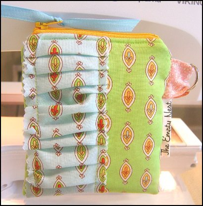 Make your own ruffled coin zipper pouch with this tutorial via {Everything Etsy}