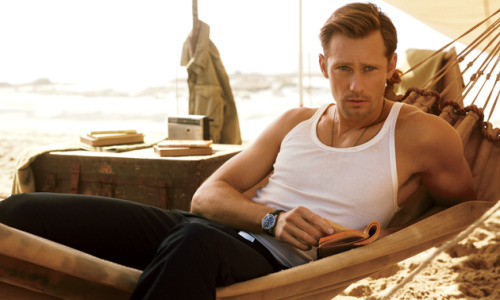 "Brett Martin Goes Whale Watching with True Blood's Alexander Skarsgard (and, uh, his Dad)  It's hard enough on a healthy male ego just kind of standing around a guy like Alexander Skarsgård, whose Viking physique, showcased to such great effect on HBO's True Blood, tends to make one feel small and soft and generally shabby in comparison. One does not need the extra discomfort of being humiliated by his dad. Skarsgård's father, Stellan, happens to be Sweden's biggest movie star, best known on these shores as the quadriplegic roughneck in Lars von Trier's Breaking the Waves or as the Swedish travel writer performing off-key ABBA songs in Mamma Mia!, depending on how you like to think of yourself. I'd called Stellan in Stockholm and informed him I was going whale-watching with his son. ""Ever since he went whale-watching, he won't stop talking about it. Everybody has to go! It's a plague!"" he affectionately complained. Then came the setup: ""Listen,"" he said, the lugubrious voice oozing authority. ""Bring a sweater. It's cold out there.""  Photo: Carter Smith"