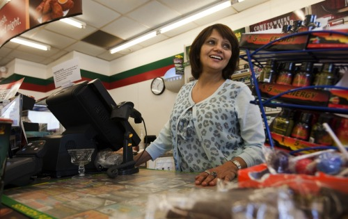 "Ranjeeta Masand at the counter of the 7-Eleven she owns on Hampton Boulevard. Ranjeeta was a leading lady during her Bollywood career in the 1970s and 1980s. She's recently been asked to return to the screen in a sequel to a movie she starred in years ago. (Bill Tiernan | The Virginian-Pilot)Read her story: ""From Bollywood to Big Gulps … and back"" by Mike Gruss"