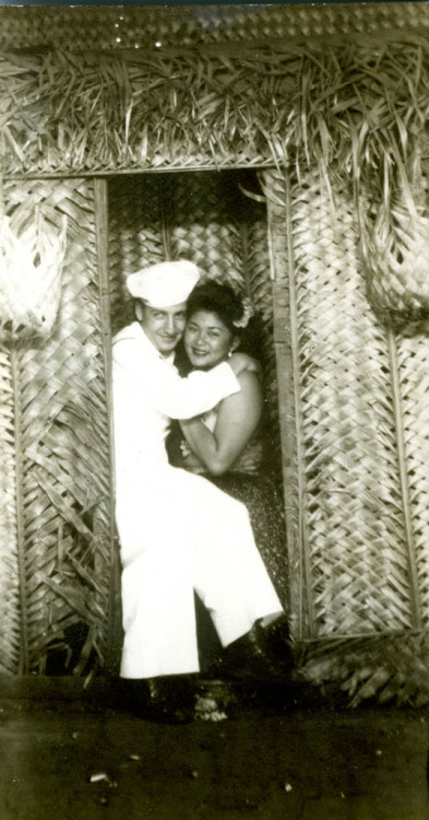 MEMORIAL DAY IS COMING - DUTY, JEWISH HERITAGE MONTH Sailor (Gerald Hirsch) hugging a Hawaiian girl in the doorway of grass hut. CB (Seabee) wears a cap, a standard-issue top and bell-bottoms.  Seabee  Gerald Hirsch in Hawaii 1944/5 Collection  of Yeshiva University Museum (1995.206) Gift  of Margit Jacobi Hirsch