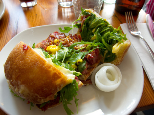 """Knuckle Sandwich:Pig knuckle, picallili, arugula, pickles"""