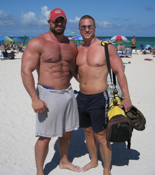 guysthatgetmehard:  rick and his hot beach buddy (and a nice bulge in his shorts)