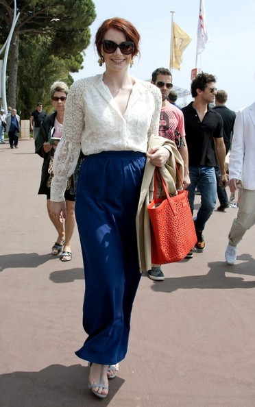 Bryce Dallas Howard wearing her Max Mara St. Moritz sunglasses in brown and toting her Kate Spade New York Garden Place Small Coal Bag to the 'Restless' photocall during the 64th Annual Cannes Film Festival on May 13th.