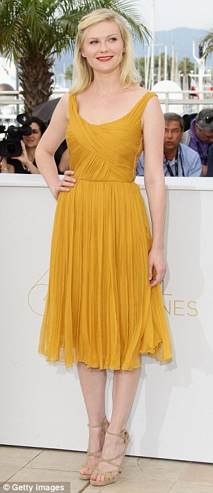 (via Cannes 2011: Kirsten Dunst is picture perfect at Melancholia photocall | Mail Online)
