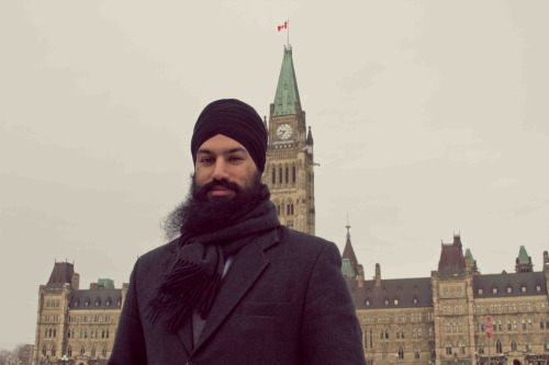Jagmeet Singh, an NDP candidate who ran in the recent Canadian election, stands in front of Canadian Parliament wearing a black dastaar, grey wool coat and matching scarf to stave off the wintry weather. Submitted by Ashveer Pal Singh.