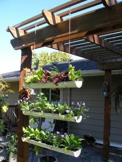 copacetic:  Hanging Garden // Re-purposed gutters (via Home & Garden | Apartment Therapy New)