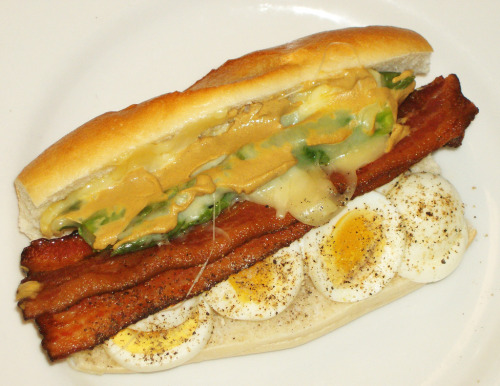 """house-made sandwich roll, near-perfect hard-boiled eggs, applewood-smoked bacon, and asparagus with melted fontina cheese and mustard."""