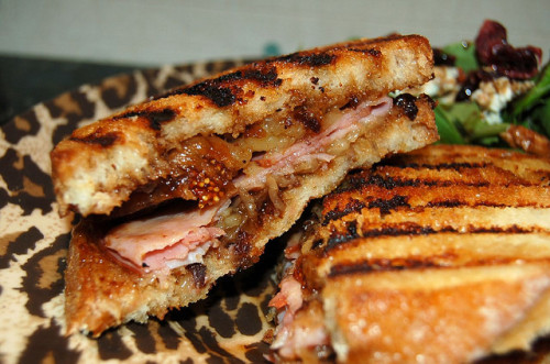 """Ham + Cheese: Rustic bread with fig preserves, fontina and honey baked ham, grilled."""