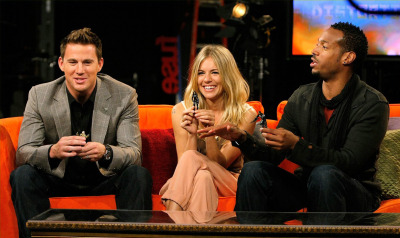 Channing Tatum (Captain Duke Hauser), Sienna Miller (The Baroness) and Marlon Wayans (Ripcord) holding their respective action figures from the movie GI JOE: THE RISE OF COBRA.  (from Getty Images)