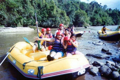White Water Rafting, Cagayan de Oro CityCirca 2000's This photo was taken at a time when digital cameras were a luxury, and disposable water-proof cameras were the way to go for these types of adventures.  This was my first time to go rafting, and the rapids of Cagayan River were superb! Jumping off a bridge in the middle of the river was also very memorable for me, as well as crossing a stream with a very strong current! I'll definitely return for a more advanced route very soon!