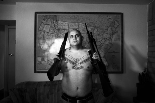 postcardsfromamerica:  Isaac at home with his guns. Las Cruces, New Mexico Paolo Pellegrin