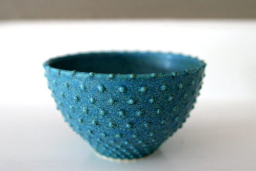 Quantum Dot A - turquoise ceramic bowl with raised dots.