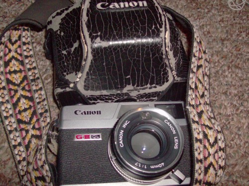 Up for sale is a Canon Canonet QL-17 GIII.  The camera is in near perfect condition cosmetically, and everything works mechanically.  The camera comes with the original case as well as a nice vintage strap.Free shipping to continental United States.  Standard charges apply to Alaska and Hawaii.PRICE: $70