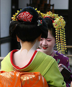 "More photos of Japanese maikos' (apprentice geisha, literally ""dancing girl"") necks and the distinctive nape cosmetics.  The inner red ""collar"" is the telltale sign of her status as apprentice."